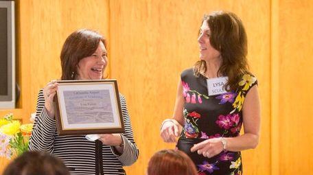 Honoree Lisa Pierce, left, receives an award Thursday,