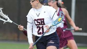 Cold Spring Harbor's Katie Hudson carries the ball