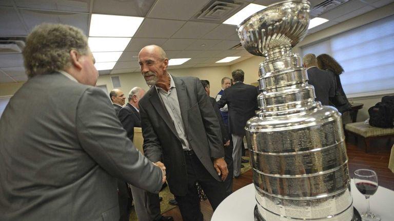 Islanders alumnus Bob Nostrom greets people during an