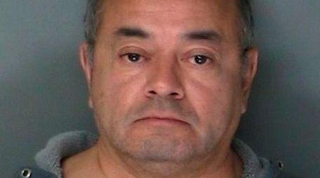 Cesar Gonzales-Mugaburu, 60, of Ridge, was arrested in