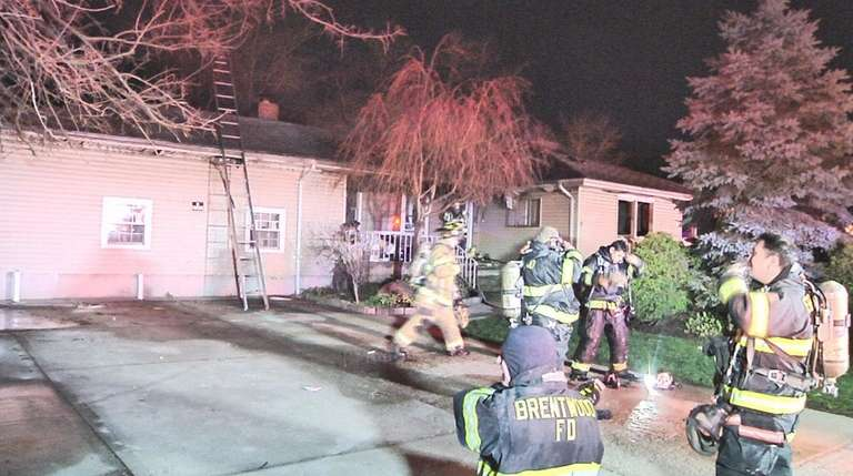 Firefighters from various departments fight the blaze at