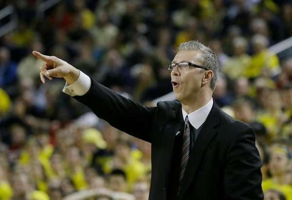 Ohio State assistant coach Jeff Boals directs