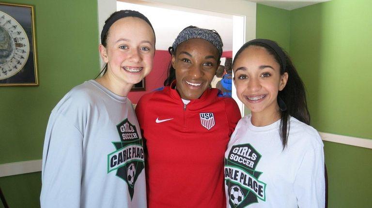 Soccer star Crystal Dunn, center, who grew up