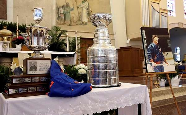 Items including the Stanley Cup adorn the altar