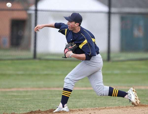 Shoreham-Wading River's Brian Morrell (23) throws a pitch