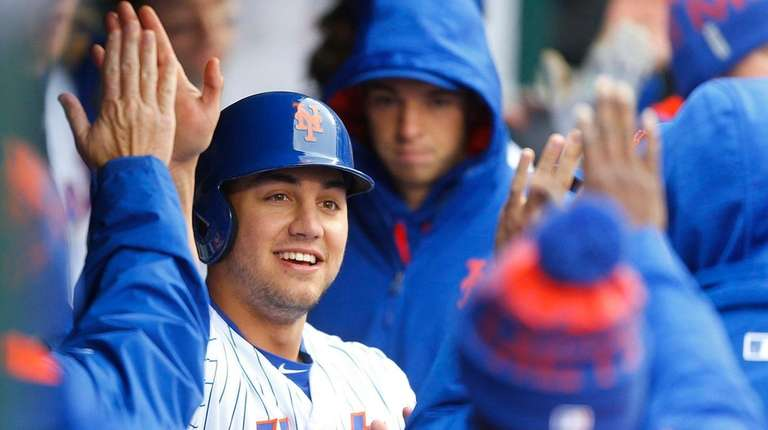 New York Mets leftfielder Michael Conforto is high-fived