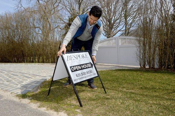 Real estate salesperson Tal Berke sets up for