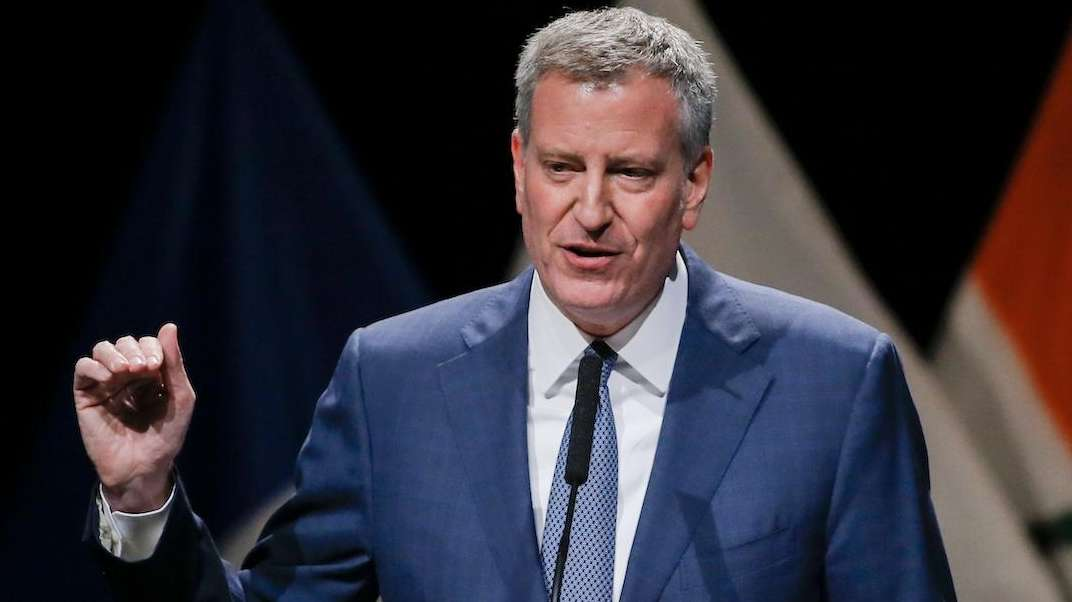 Mayor Bill de Blasio is shown giving a