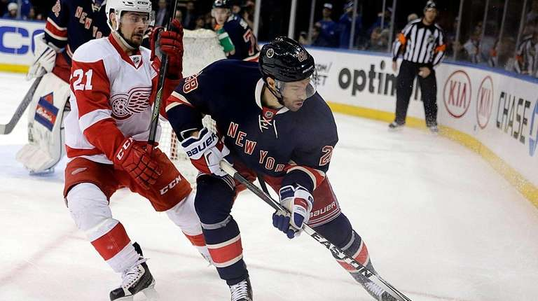 Detroit Red Wings left wing Tomas Tatar defends