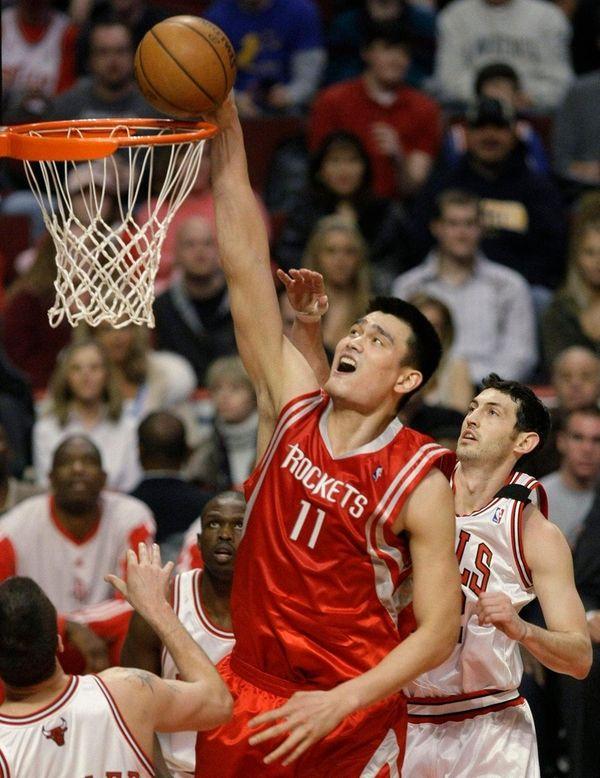 Houston Rockets center Yao Ming dunks the ball