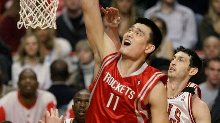 Houston Rockets center Yao Ming dunks the ball
