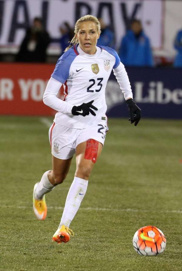 United States midfielder Allie Long (23) moves down