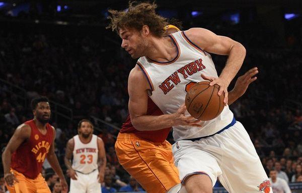 New York Knicks center Robin Lopez spins past