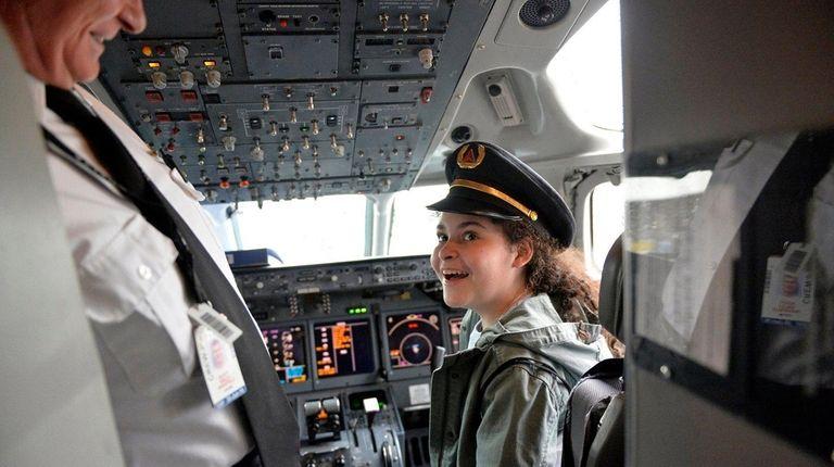 Woodside resident Laila Abdelnapy, 10, wears a pilot's
