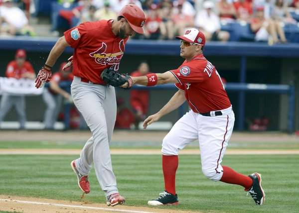Ryan Zimmerman of the Washington Nationals tags out