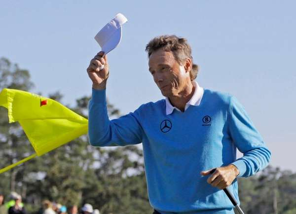 Bernhard Langer, of Germany, tips his cap after