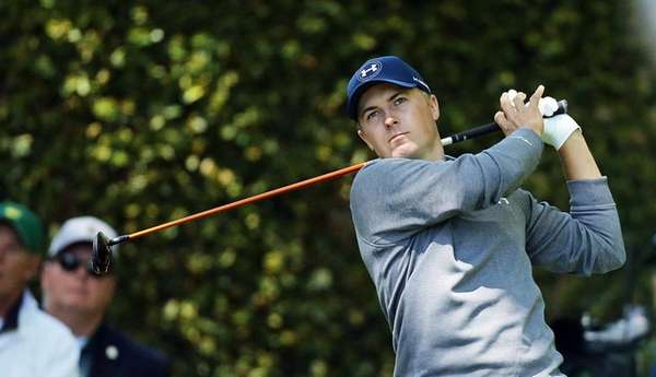 Jordan Spieth plays his shot from the 2nd