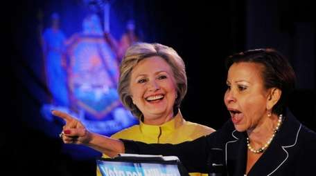 Democratic presidential candidate Hillary Clinton listens to Congresswoman