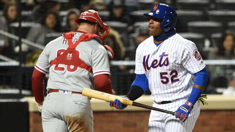 Yoenis Cespedes, right, walks back to the