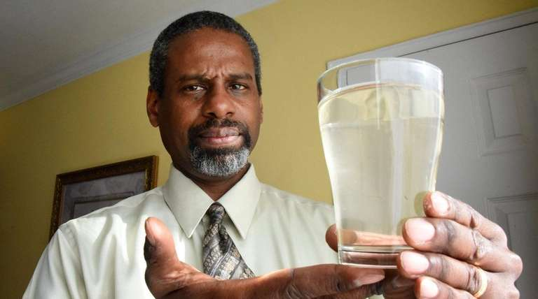 Lakeview resident Reginald Baron holds a glass of