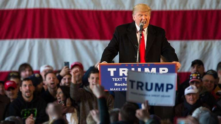 Republican presidential candidate Donald Trump speaks in front