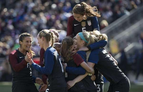 United States' Julie Johnston, center right, celebrates her