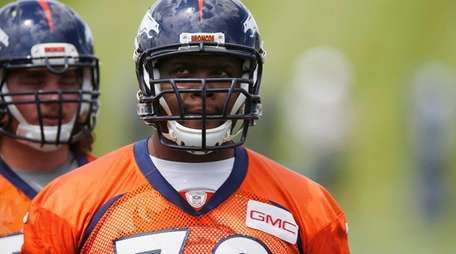 Tackle Ryan Clady waits to take part in