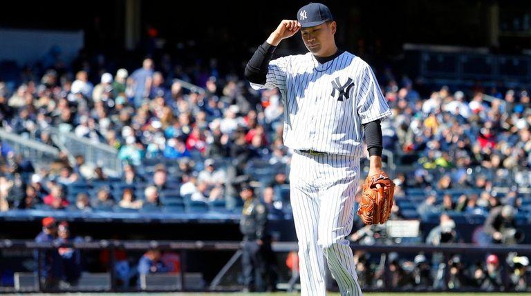 Masahiro Tanaka of the New York Yankees leaves