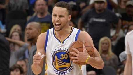 Golden State Warriors guard Stephen Curry celebrates the