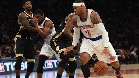 New York Knicks forward Carmelo Anthony dribbles the