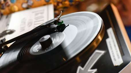 A vinyl record spins on a Gramovox floating