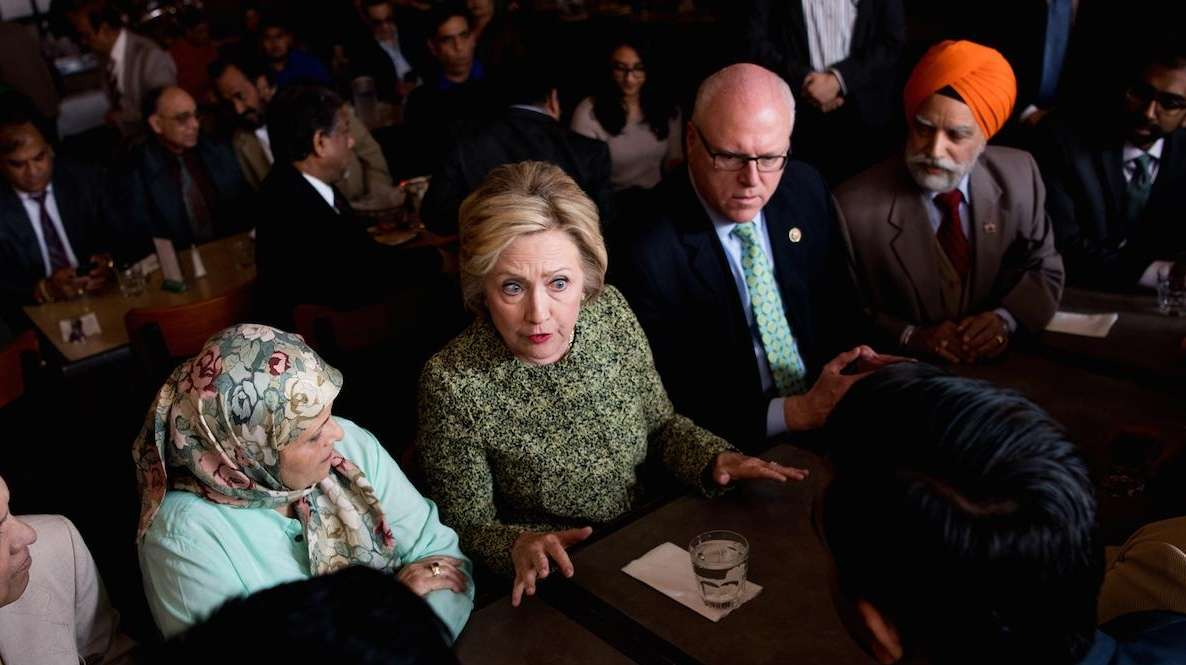 Democratic presidential candidate Hillary Clinton talks with patrons