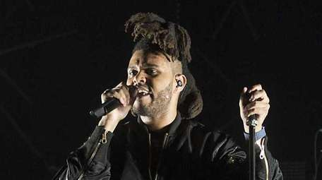 The Weeknd performing during the Billboard Hot 100