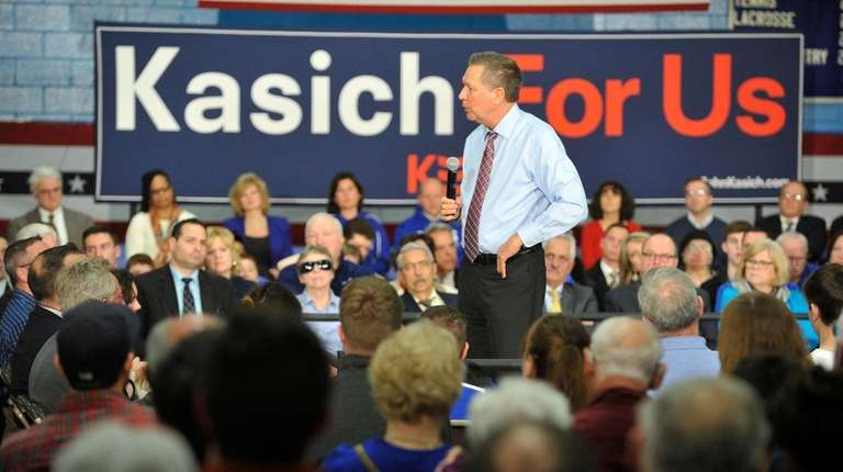 Republican presidential candidate John Kasich talks to Capital