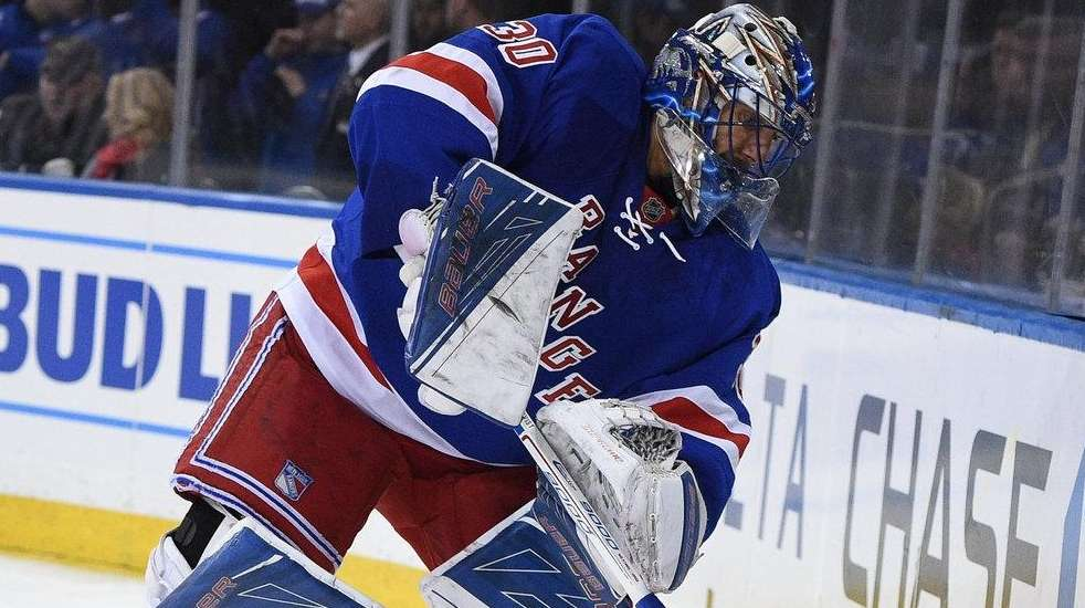 New York Rangers goalie Henrik Lundqvist clears