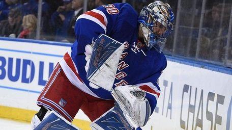 New York Rangers goalie Henrik Lundqvist clears