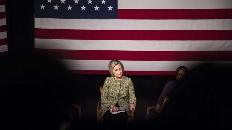 Democratic presidential candidate Hillary Clinton holds a conversation