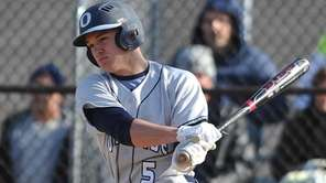 Oceanside shortstop Kyle Martin hits a run-scoring single