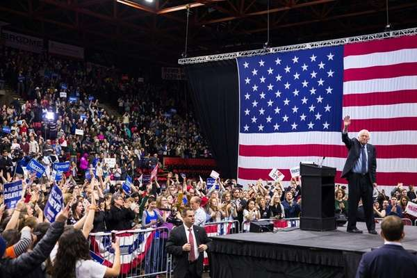 Democratic presidential candidate Bernie Sanders waves to the