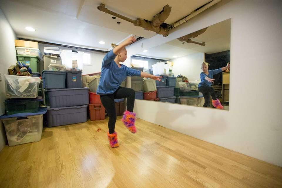Emily Nelson, 10, practices her dance moves in