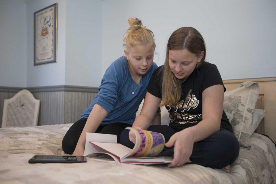 Emily Nelson, 10, left, and her sister Lauren,