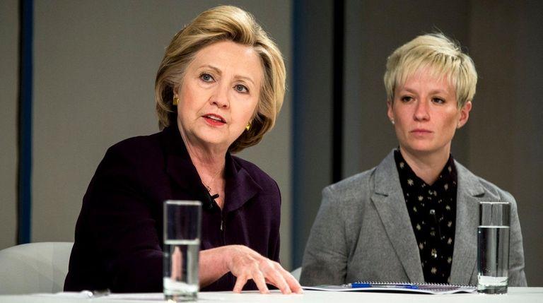 Hillary Clinton, left, with Megan Rapinoe, of the