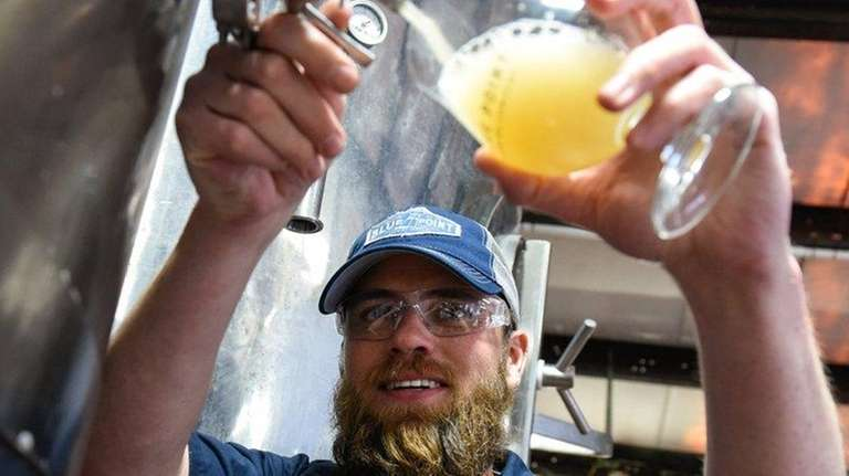 Brewmaster Dan Jansen pours a tulip glass for