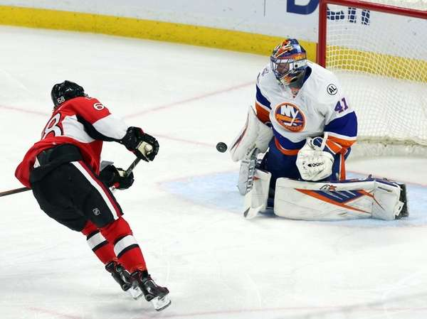 New York Islanders goalie Jaroslav Halak (41) stops