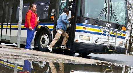 Riders boarding a Suffolk Transit bus in Brentwood