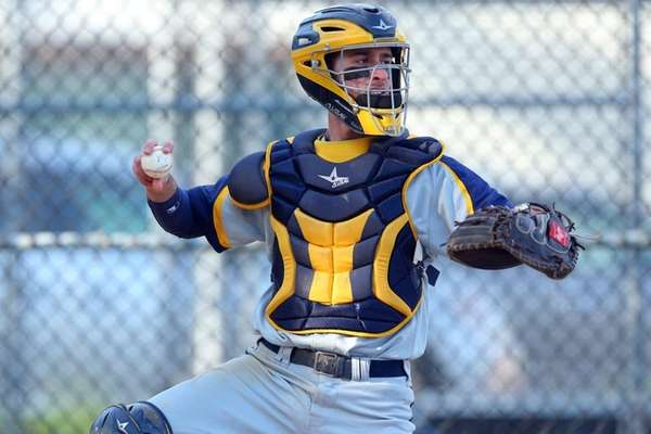 Jericho catcher Nico Doria throws during a game