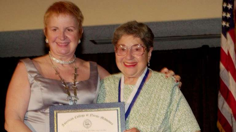 Shirley Okrent (right) at her induction as an