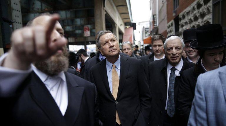 Republican presidential candidate Ohio Gov. John Kasich walks