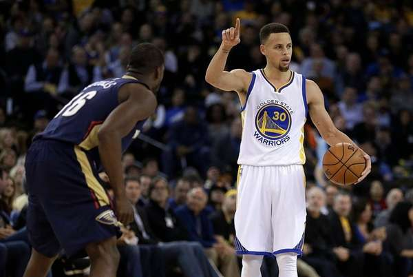 Golden State Warriors' Stephen Curry, right, gestures beside