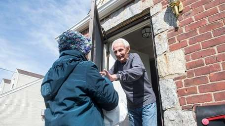 Donald Wiessner, 87, of Westbury receives a Meals